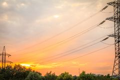 High voltage power transmission towers with electrical energy wi Royalty Free Stock Images