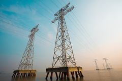 The high-voltage power transmission towers Stock Photos