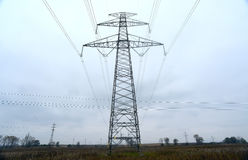 High-voltage power transmission towers in polluted gray sky  on Nov 1, 2014 Royalty Free Stock Images