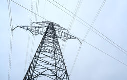 High-voltage power transmission towers in polluted gray sky  on Nov 1, 2014 Royalty Free Stock Photo