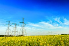 High voltage powerline on field background Royalty Free Stock Images