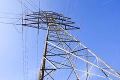 High voltage pylon. Isolated high tension electrical wire tower Royalty Free Stock Image