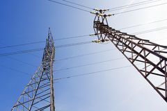High voltage pylon. Two high tension electrical wire towers Royalty Free Stock Photos