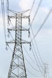 High voltage pylon. High voltage electricity pylon and blue sky Stock Photo