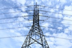 High voltage pylon. High voltage electricity pylon and blue sky Royalty Free Stock Image