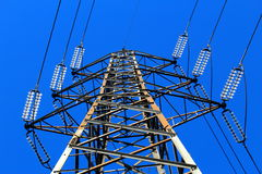 High voltage pylon. Against blue sky Royalty Free Stock Images