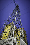 High Voltage Pylon In Front Of Houses, Urban Scene Stock Image