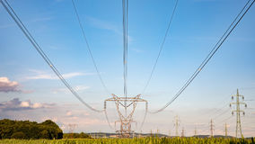 High voltage pylon on skies background, Transmission line tower. High voltage pylon on skies background, Transmission line tower in countryside Royalty Free Stock Photography