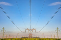 High voltage pylon on skies background, Transmission line tower. High voltage pylon on skies background, Transmission line tower in countryside stock photography