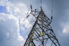 High-voltage pylon towering in cloudy sky of sunny summer Royalty Free Stock Images