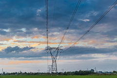 High voltage pylons in  countryside in Italy Royalty Free Stock Images