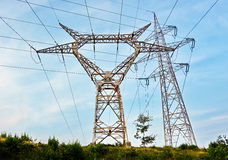 High voltage. Pylons of high voltage line, on a blue sky Royalty Free Stock Photo