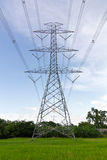 High voltage pylons on the paddy field, Thailand. Stock Photos