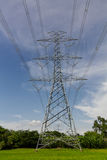 High voltage pylons on the paddy field, Thailand. Stock Image
