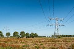 High voltage pylons with power lines Stock Photo