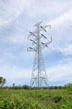 High voltage pylons and power lines to the power station. Royalty Free Stock Image