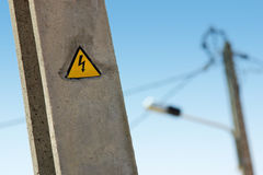 High Voltage Sign. Electric high voltage sign on a street light pole Royalty Free Stock Photo