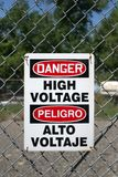 High voltage sign. In english and spanish royalty free stock photography
