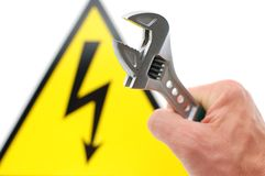 High voltage sign. And spanner Royalty Free Stock Image