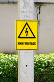 High voltage sign on electric pole in park Stock Photos
