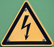 High voltage sign. On green background Stock Images