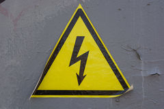 High voltage sign on grey wall Royalty Free Stock Photo