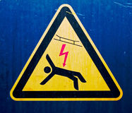 High voltage sign on  old metal surface Royalty Free Stock Photos
