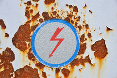 High voltage sign on rusty metal Royalty Free Stock Image
