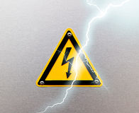 High voltage sing on metal background Stock Photography