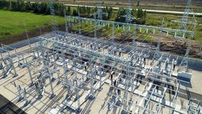High voltage substation consists of auto transformers in summer. Drone view high voltage substation consisting of power transformers, auto transformers and shunt stock video