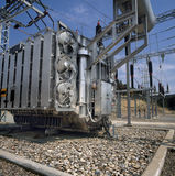 High-voltage supply transformer at power plant Royalty Free Stock Photos