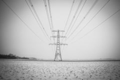 High voltage supply with powerlines in wintertime. High voltage mast, electricity supply in all weather conditions picture taken in the Netherlands royalty free stock images