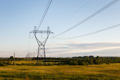 High voltage support. Support of high-voltage transmission line against the sky Stock Photo