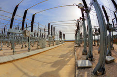High voltage switchyard in fisheye perspective Royalty Free Stock Photos