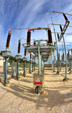 High voltage switchyard in fisheye perspective Royalty Free Stock Images