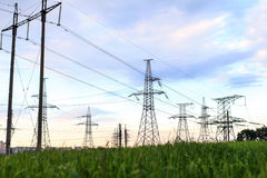 High-voltage tower. On field Stock Photos