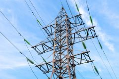 High voltage tower against the blue sky. royalty free stock photos