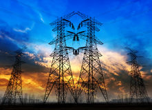 High voltage tower. Against a sky at sunset Royalty Free Stock Photos