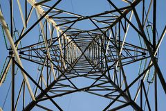 High voltage tower from below with symmetric view frame stock image