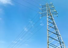High voltage tower with blue sky in background.  Royalty Free Stock Photos