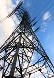 High-voltage tower  blue sky background. Stock Photo