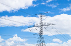 High voltage tower. With blue sky background Stock Photos