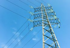 High voltage tower with blue sky in background.  Royalty Free Stock Images