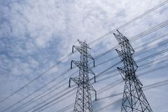 High-voltage tower with blue sky and cloud. stock images