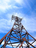 High-voltage tower on blue sky. High-voltage tower with wires with wide angle fisheye view royalty free stock photography