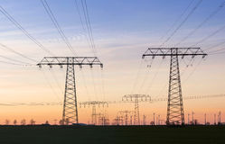 High voltage tower and cable line in the sky.  Royalty Free Stock Photos