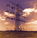 High voltage tower and cable line in the sky.  Stock Photography