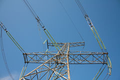 High voltage tower with cables. Metal tower with high voltage power Stock Image