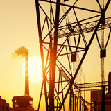 High voltage tower and chimney Royalty Free Stock Image
