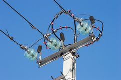 High voltage tower electric post. And wires on blue sky background Stock Photography